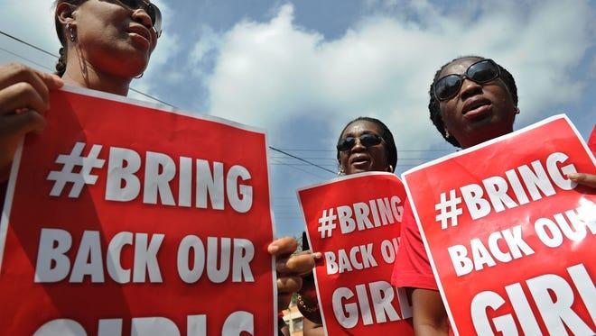 Nigerian women in Kenya demonstrate on May 16, 2014, for the release of Nigerian school girls kidnapped in northern Nigeria by members of Boko Haram.
