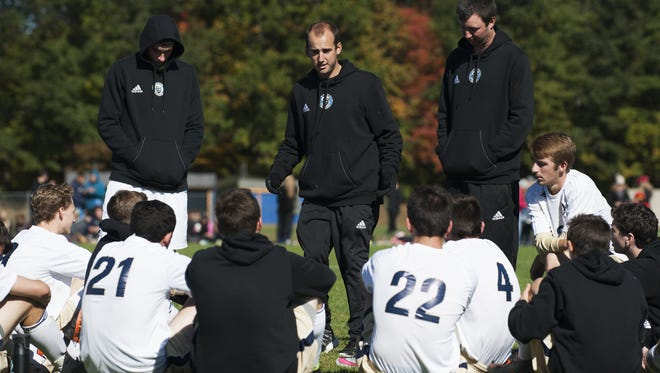 Essex head coach Jake Orr (middle) talks to his team at the half during a high school boys soccer game Saturday.