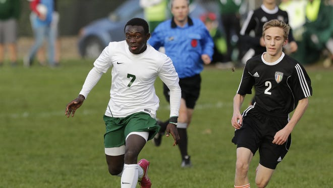 Oshkosh North senior Lamin Jarju was named the Player of the Year in the Fox Valley Association.