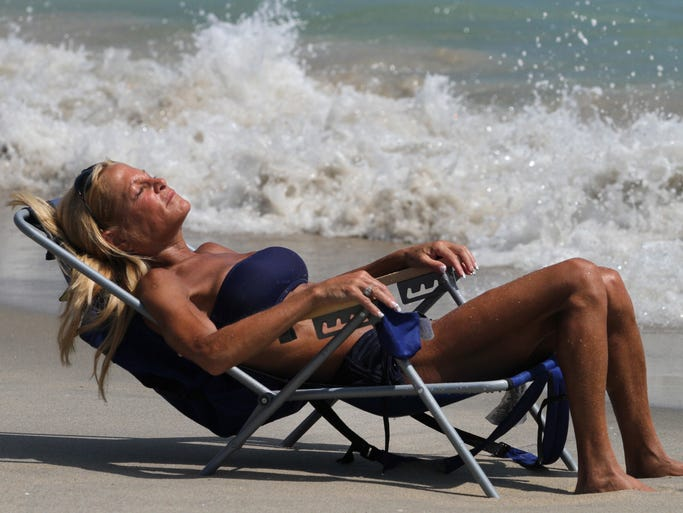 ASB 0902 Hot Weather  Lisa Rosenkrantz, of Wayne, lounges by the waters edge in Asbury Park, to keep cool from the 90+ degree temperatures, Tuesday, September 2, 2014. Mary Frank/Staff Photographer