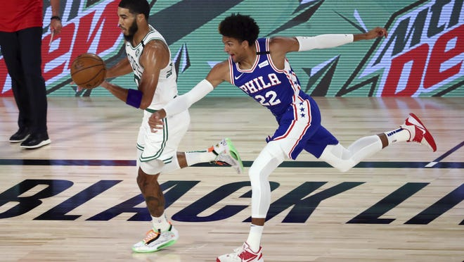 Philadelphia guard Matisse Thybulle tries to contain Boston's Jayson Tatum during the first quarter of Game 4 of their first-round playoff series on Sunday.  The Celtics won the series in four games and will face Toronto in Round 2.