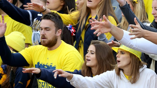 Michigan football fans make noise in the student section at Michigan Stadium in Ann Arbor on Sept. 13, 2014.
