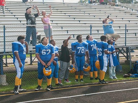 Members of Hilbert Middle School's football team watch