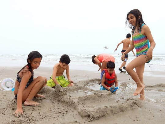 Children build a sand castle during spring break Thursday, March 17, 2016, at the South Packery Channel in Corpus Christi.