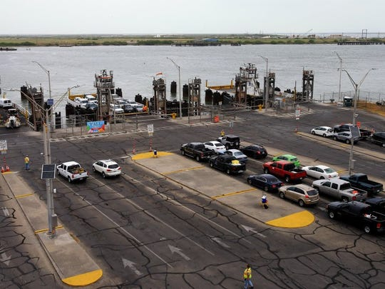 GABE HERNANDEZ/CALLER-TIMES Vehicles prepare to cross from Port Aransas to Aransas Pass on Tuesday, July 27, 2016, at the Port Aransas Ferry.