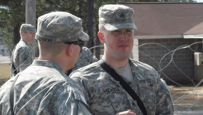 Army Sgt. Anthony Gazvoda, 31, of Grayling, during his 2009 tour of duty in Afghanistan, where he was engaged in 34 firefights and shot at hundreds of times while working as a road clearance specialist.