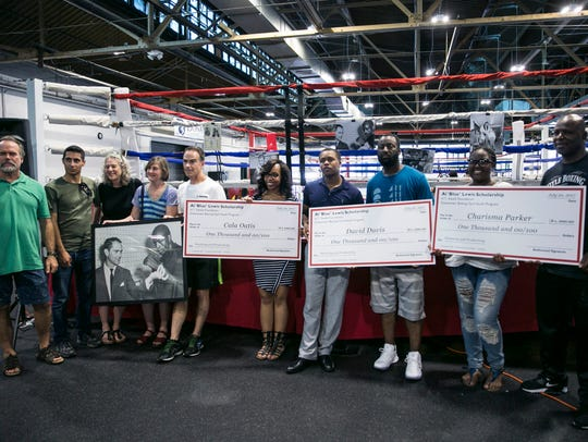Scholarship recipients received their checks at a the