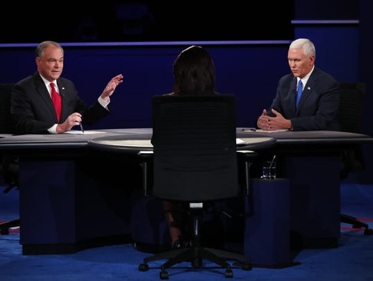 Tim Kaine interjects as Mike Pence, Donald Trump's running mate, speaks during the vice-presidential debate in Farmville, Va.