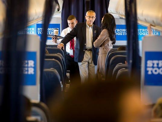 John Podesta, Hillary ClintonÕs campaign chairman, talks with Huma Abedin aboard her flight to Miami.