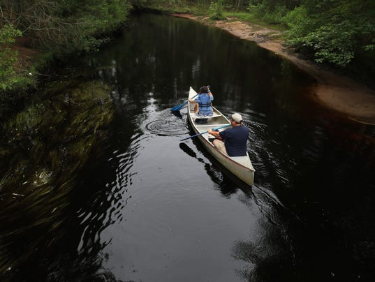 The American Littoral Society conducts a canoe tour down the Wading River to teach people about the Pine Barrens.