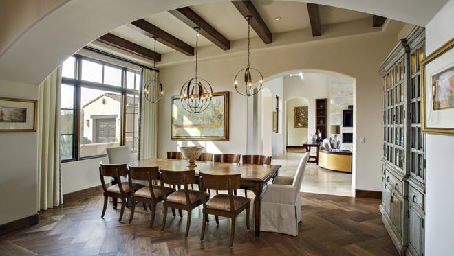"""The homeowners like to entertain and use the formal dining room quite often. """"Most people say they never use their dining room, but we use it all the time when we have company. I don't want those rooms we don't use,"""" says Kim."""