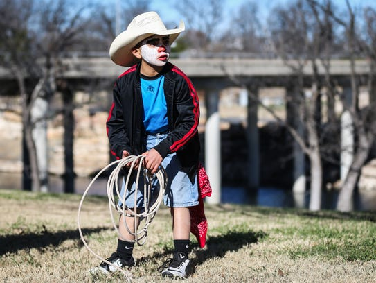 Eleazar Carbajal, 9, plays with a rope during the Rodeo
