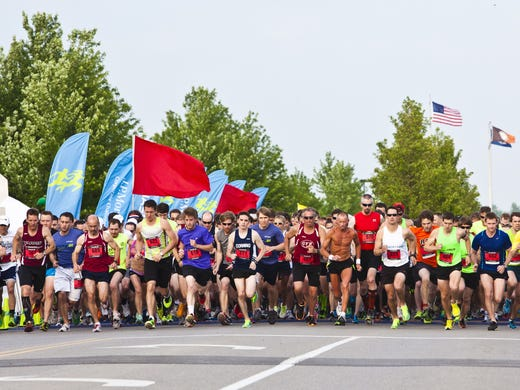 The participants of the J.P. Morgan Corporate Challenge Championship take off from the starting line.