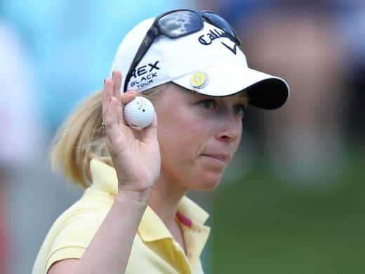 Morgan Pressel waves after saving par on No. 18 during third-round play of the Wegmans LPGA Championship on Sunday.