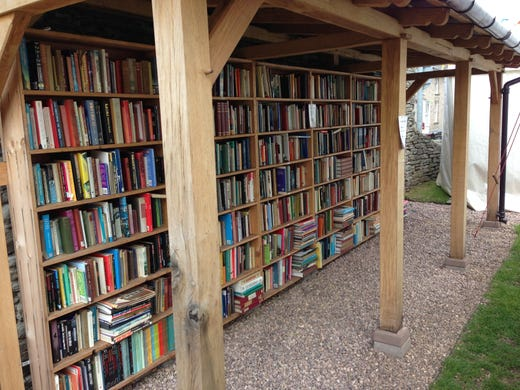 An outdoor bookstall erected for the 2013 Hay Festival in Hay-on-Wye, Wales. The town is home to about 30 secondhand bookstores, serving a population of just 1,500. It has only three ATMs.
