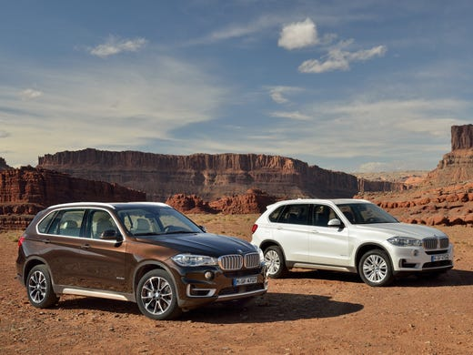The new third-generation 2014 BMW X5 -- that's an xDrive 50i model, left and xDrive 35d diesel -- has a starting price up 11% from 2013. And the least expensive X5 for 2014 -- $53,725 with shipping -- is rear-drive now, not all-wheel-drive.  <p></p>