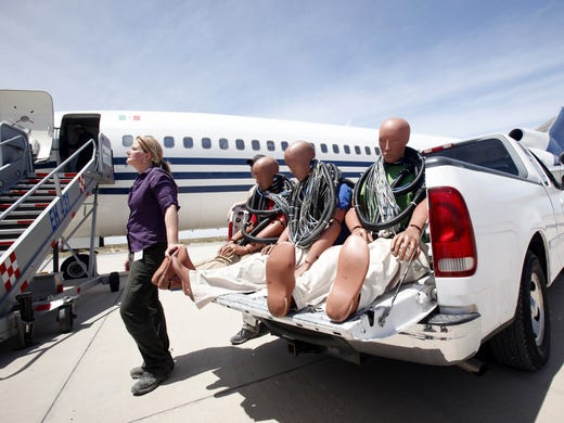Cindy Bir, a professor of biomedical engineering at Wayne State University,  waits to board crash dummies wired with sensors onto a 727. The jet was intentionally crash-landed by Discovery Channel program <i>Curiosity</i> to measure what happens to people and equipment in the crash of a big commercial jet.