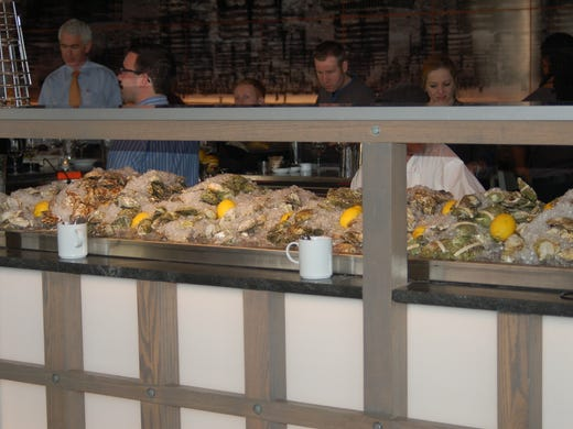 You cannot miss it: ultra-fresh oysters displayed on ice serve as the restaurant's centerpiece.