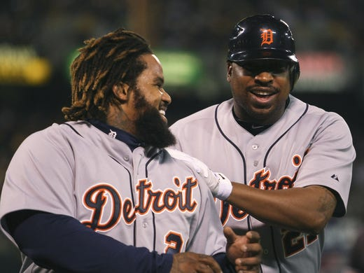 Game 5: Tigers first baseman Prince Fielder, left, and DH Delmon Young are all smiles after scoring in a four-run seventh inning of a 6-0 series-clinching win Thursday vs. the A's.