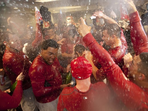 Game 5: St. Louis Cardinals teammates douse each other in the clubhouse with champagne and beer after they rallied to beat the Washington Nationals 9-7 to advance to the NLCS.
