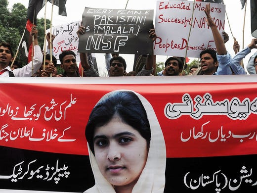 Protesters shout slogans during a demonstration against a Taliban assassination attempt on child activist Malala Yousufzai on Monday in Lahore, Pakistan.