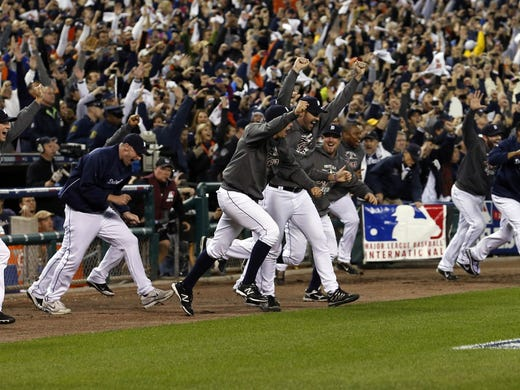 Game 4: Detroit Tigers players run out of the dugout after winning Game 4 of the ALCS against the New York Yankees.