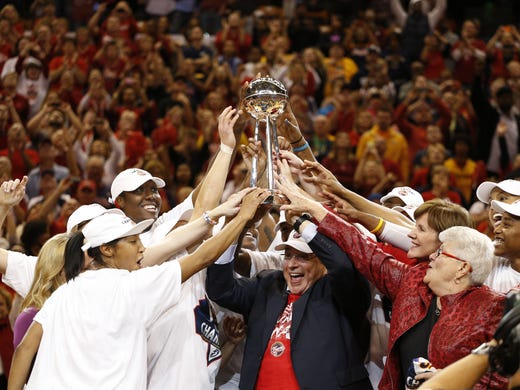 Game 4: Indiana Fever owner Herb Simon and his team hoist the WNBA championship trophy after beaing the Lynx 87-78 Sunday to win their first championship.