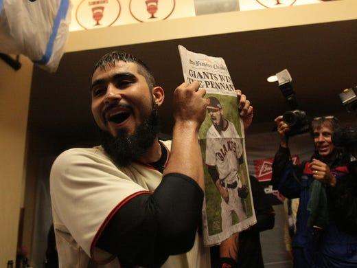 Sergio Romo celebrates in the clubhouse.