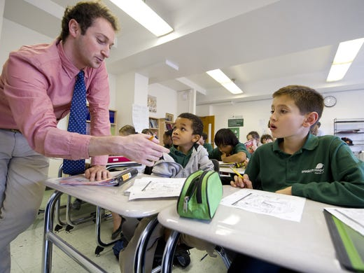Brooklyn Prospect Charter School is a 4-year-old integrated middle and high school in Brooklyn, N.Y. Here,  teacher Sam Brill works with with Jacob, left, and Lucca.