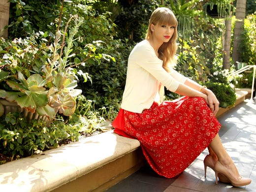"In the calm before the storm that was the release of her new album, ""Red"", Taylor Swift paused to pose for a portrait in Los Angeles on Oct. 17 before heading to New York for a series of appearances celebrating the CD release."