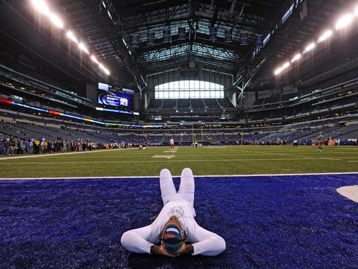 Miami Dolphins defensive end Cameron Wake stretches out before their game against the Indianapolis Colts at Lucas Oil Stadium.