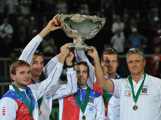 The Czech Republic's Davis Cup Team (L-R) Ivo Minar, Lukas Rosol, Radek Stepanek, Tomas Berdych and captain Jaroslav Navratil pose with the trophy.