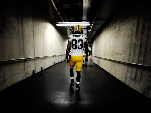 Green Bay Packers tight end Tom Crabtree (83) walks to the field prior to the game against the Detroit Lions at Ford Field.