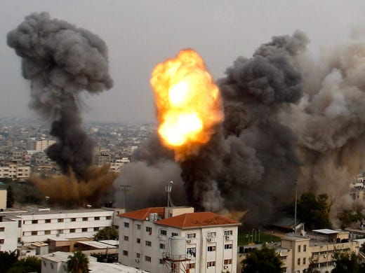 Israeli bombs pound a target on Nov. 21 in Gaza City. Israeli warplanes and artillery pounded Gaza, hitting government ministries, smuggling tunnels and other targets.