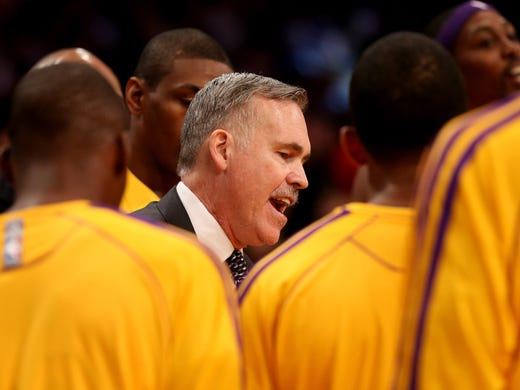 Mike D'Antoni coached the Lakers for the first time Tuesday, leading them to a tight 95-90 victory against the Nets that was defined by strong play down the stretch. Flip through for more photos from the game.
