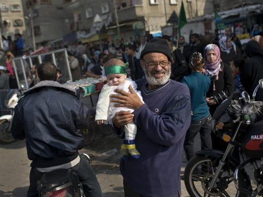 A Palestinian baby wears a Hamas bandana during a rally to celebrate the Israel-Hamas cease-fire in the Jebaliya refugee camp, north Gaza Strip on Nov. 22.