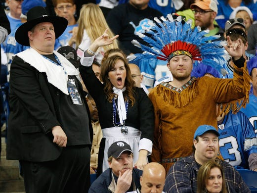 Fans dressed like pilgrims and Indians cheer on Thanksgiving Day during the game between the Detroit Lions and the Houston Texans at Ford Field.