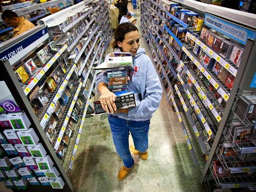 Tonya Thomas shops for Black Friday deals at a Best Buy store on Nov. 23 in Bowling Green, Ky.