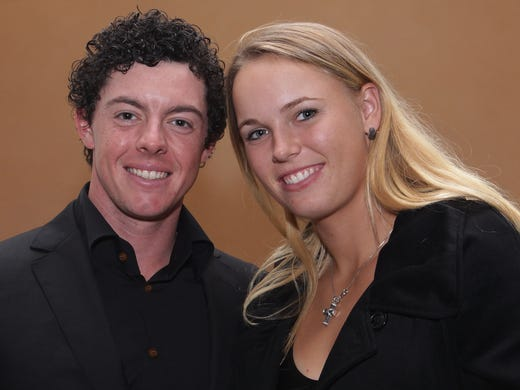 One of sports' power couples, Rory McIlroy of Northern Ireland and  Caroline Wozniacki of Denmark. McIlroy is golf's world No. 1, and Wozniacki is a former No. 1 in tennis. The two have been dating since the summer of 2011 (as far as we can tell). Wozniacki was alongside for a huge year for McIlroy: Five wins in 24 starts, including the PGA Championship (second major title), money titles on both tours and a record $11,953,586 in earnings. Good luck charm?
