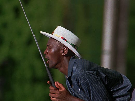 Michael Jordan can't believe he missed the putt on the 18th green on Saturday, June 26, 1993 at Brook Valley Country Club during practice rounds for a golf tournament in Greenville, N.C. ,1993.