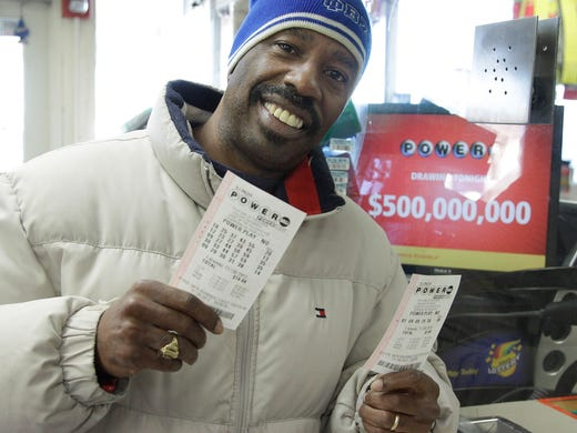 Lamar Fallie buys six Powerball tickets at a BP gas station Nov. 28 in Calumet Park, Ill. Fallie, who is unemployed, said he doesn't normally play the lottery but was lured by  the $550 million jackpot.