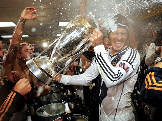 Beckham is sprayed with champagne by his Galaxy teammates.
