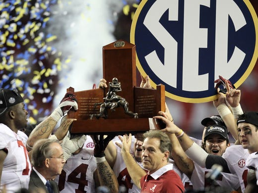 Nick Saban and his Crimson Tide hoist the SEC Championship trophy after defeating Georgia.