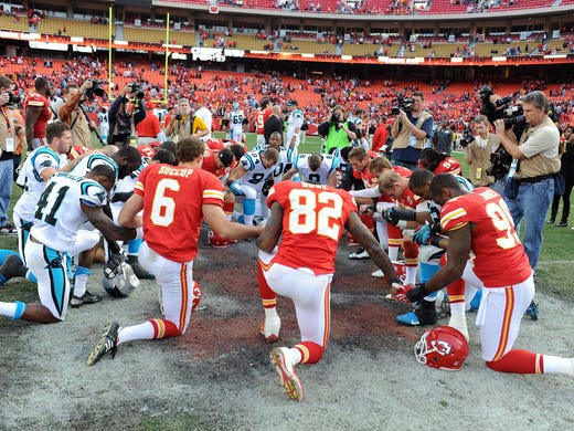 Chiefs and Panthers players kneel for a prayer after the game at Arrowhead Stadium. The game was played just one day after the murder-suicide involving Jovan Belcher. Kansas City won the game 27-21.