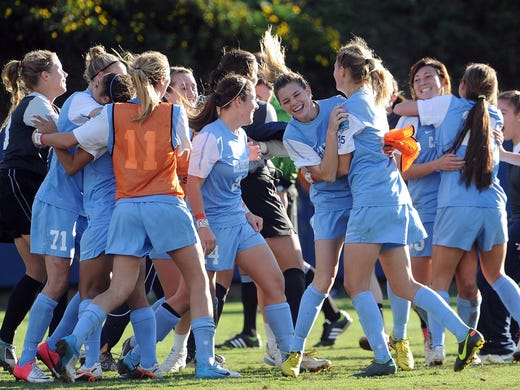 The North Carolina Tar Heels celebrate after defeating the Penn State Nittany Lions 4-1 to win the NCAA Women's College Cup for a record 21st time.