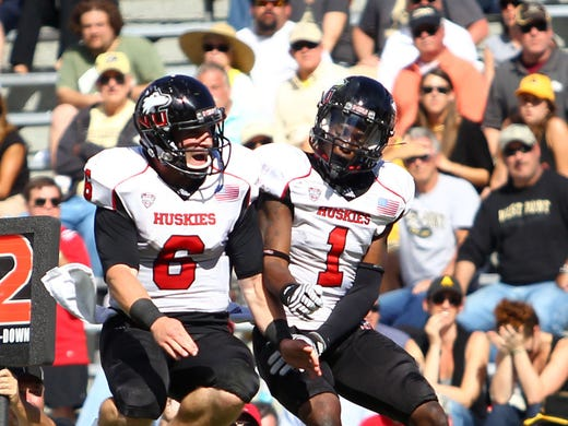Northern Illinois Huskies wide receiver Martel Moore (1) celebrates with quarterback Jordan Lynch (6) after catching a touchdown against Army Black Knights in the fourth quarter of the team's 41-40 win.