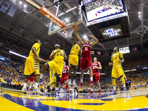 Wisconsin Badgers guard Ryan Evans (5) shoots over Marquette Golden Eagles' forward Jamil Wilson (0) during the first half at the BMO Harris Bradley Center. Marquette won 60-50.