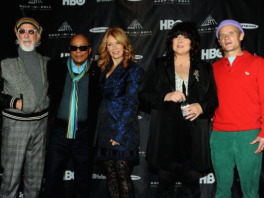 From left, Ahmet Ertegun Award recipients Lou Adler and Quincy Jones with inductees Ann Wilson and Nancy Wilson of Heart and Red Hot Chili Pepper's Flea, who acted as MC during the Rock and Roll Hall of Fame 2013 Inductees announcement in Los Angeles on Tuesday.