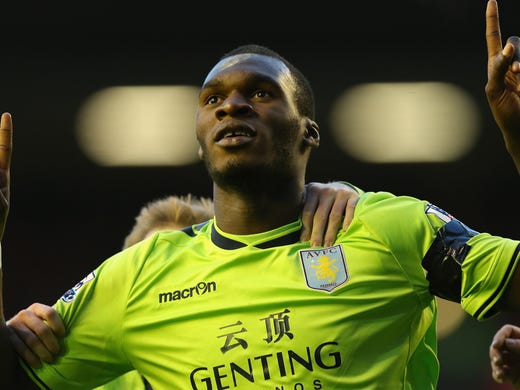 Players on Aston Villa, Liverpool, QPR and Fulham all wore black armbands to honor the victims of Friday's tragedy in Connecticut. Here, Villa's Christian Benteke celebrates his goal in a 3-1 win.