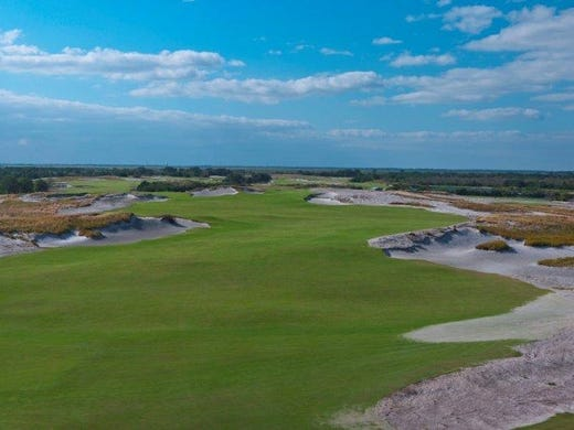 Streamsong Golf Resort is a 16,000-acre, windswept home to towering sand dunes and sand-based contours; natural bunkers; elevation changes even in the Sunshine State; 100-foot deep water ponds; and abundant native vegetation including natural wild grasses. It is located in southwest Polk County near Ft. Meade — a 60-minute drive east of Tampa and 90 minutes southwest of Orlando. There are two courses, Blue and Red. This is No. 1 on the Blue Course. Streamsong opens Dec. 21.